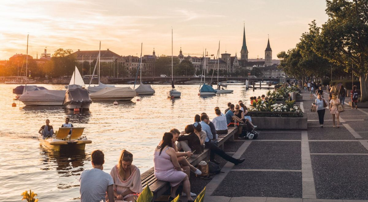 People eating along the river of Zurich